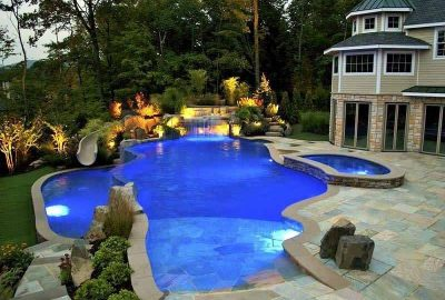 Freeform Vanishing Edge Pool with Custom Slide Waterfall Spillover