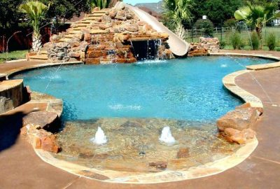 Freeform Lagoon Pool with Beach Entry Deck Jets Bubblers and Rock Slide Grotto