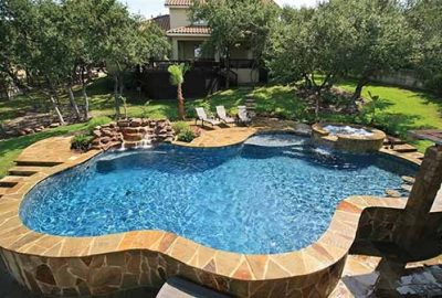 Freeform Pool with Raised Spa Rock Waterfall Tanning Ledge