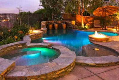 Freeform Pool with Raised Wall Raised Spa Tanning Ledge Built-in Fire Pit