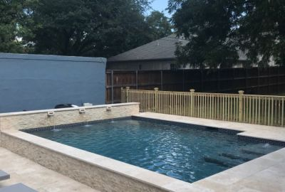Geometric Pool with raised wall scuppers