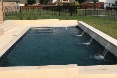 Geometric Pool with raised wall with sheer descents