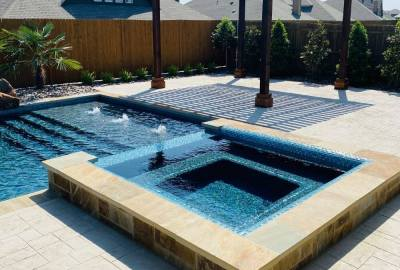 Geometric pool and raised spa with steps