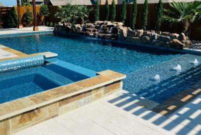 Geometric pool and spa with bubblers and rock waterfalls