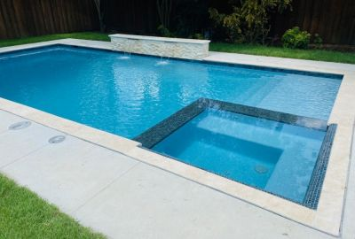 Geometric pool with level spa and raised wall sheer descents