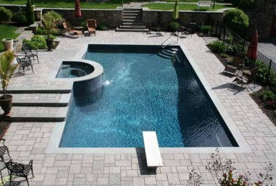 Geometric Pool with Raised Spa and Diving Board