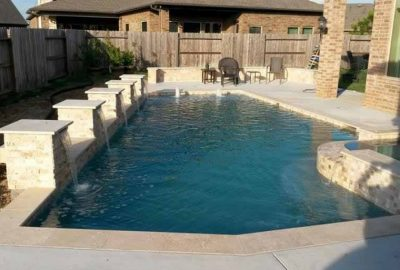 Geometric Pool with Raised Spa Columns with Sheer Descents