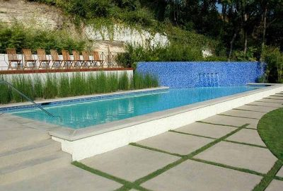 Geometric Pool with Raised Tile Wall Fountains and Pool Landscaping