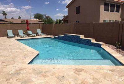 Geometric Pool with Raised Wall Travertine Deck