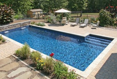 Geometric Pool with Raised Wall Pool Landscaping Sheer Descents
