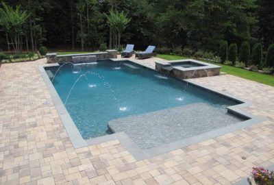 Geometric Pool with Raised Wall Sheer Descents Deck Jets Tanning Ledge
