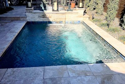 Geometric pool with raised wall