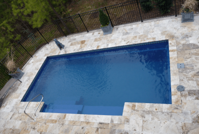 Geometric Pool with Travertine Deck