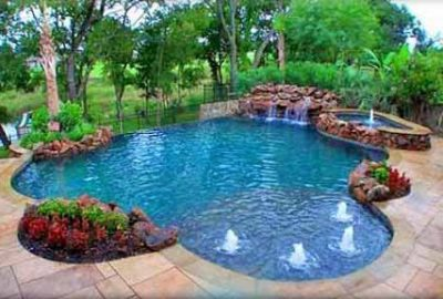 Lagoon Style Freeform Pool with Rock Waterfall Grotto Raised Spa Bubblers
