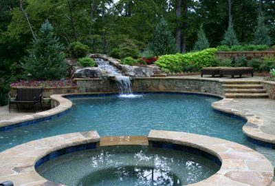 Freeform Pool and Spa with Rock Waterfall Flagstone Deck