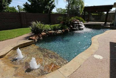 Freeform Pool with Beach Entry Bubblers and Rock Waterfall