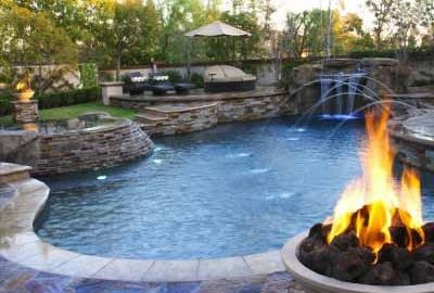 Freeform Pool with Fire Bowls Deck Jets