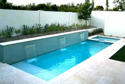 Geometric Pool and Spa with Raised Tile Wall Sheer Descents