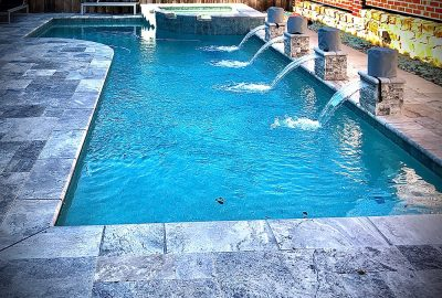geometric pool with raised fountains and spa