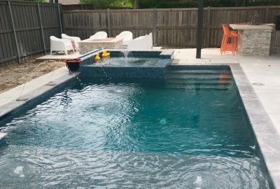 Geometric Pool with Raised Spa and Deck Jets